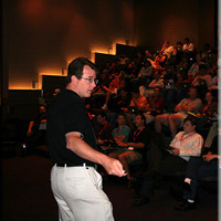 Dave Presenting in an Auditorium